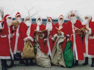 Weihnachtsmänner in Arbeitskluft